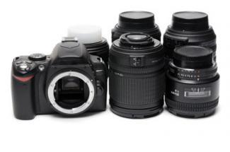 166595-325x215-DSLR-Camera-with-Lens.jpg